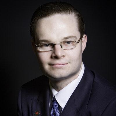 portrait photo of Adam Wakeling