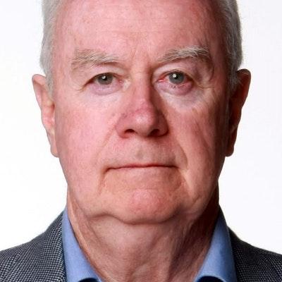 portrait photo of Paul Kelly