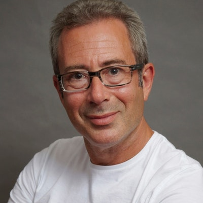 portrait photo of Ben Elton