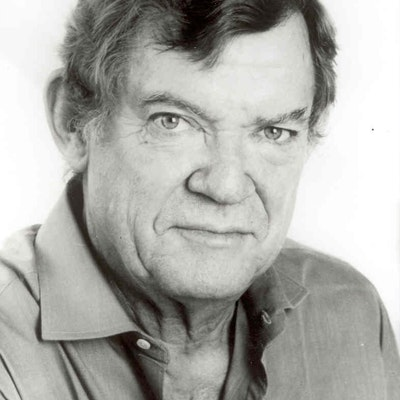 portrait photo of Robert Hughes