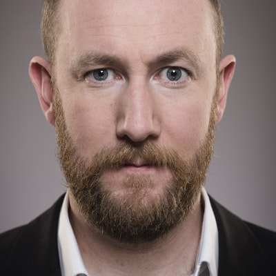 portrait photo of Alex Horne