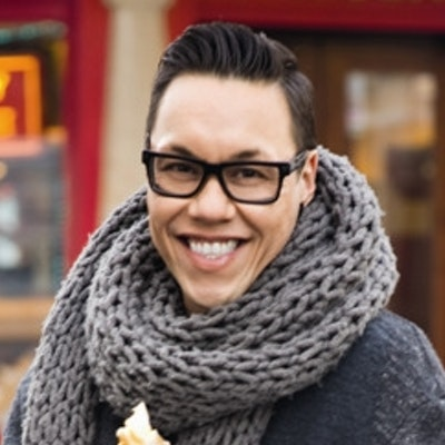 portrait photo of Gok Wan