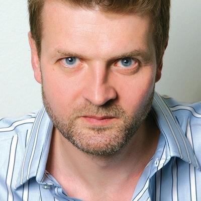 portrait photo of Adam Taor