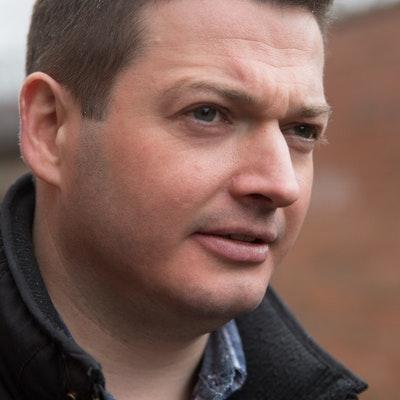 portrait photo of Aaron Edwards