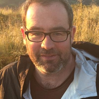portrait photo of Thom Conroy