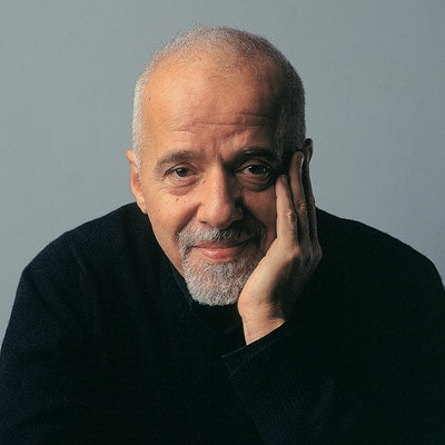portrait photo of Paulo Coelho