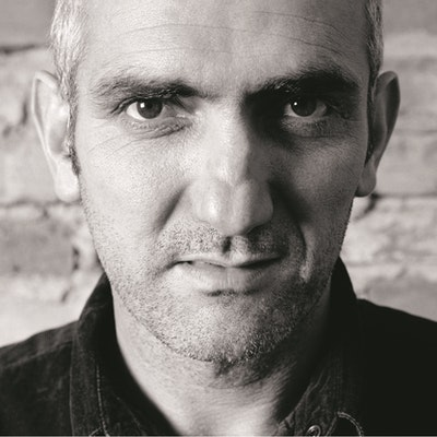 portrait photo of Paul Kelly